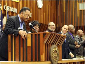 The Rev. Jesse Jackson tells an audience at the UAW hall that Toledo deserves the same attention as Afghanistan, Iraq, and Wall Street, which he said benefited from targeted intervention.