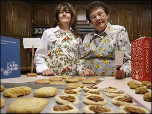 Diana Randolph, left, and her mother, Gloria Carpenter, have had cookie exchange parties for 10 years.