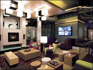The Aloft Lexington hotel in Lexington, Mass., offers fashionable decor at a cheaper price - $119 per night compared with the $399 to $639 demanded at W Hotels, Aloft's upscale sister hotel.