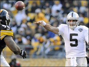 Oakland quarterback Bruce Gradkowski throws a pass against the Pittsburgh Steelers. The University of Toledo product is 2-1 as the starting QB for the Raiders.