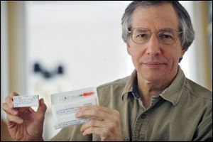 Larry Friedman displays vials of the insulin drug Vetsulin. Mr. Friedman has filed suit against the drug's manufacturer, Schering-Plough Animal Health, in U.S. District Court, Toledo, alleging negligence, violation of consumer sales practice, breach of warranty, and defective product.