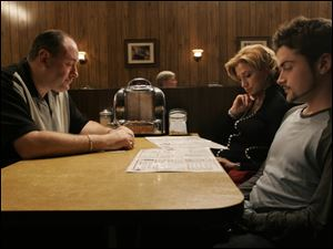 From left, James Gandolfini, Edie Falco and Robert Iler in the final scenes from the series finale of the HBO drama television series 'The Sopranos'.