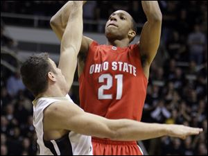 Ohio State's Evan Turner shoots over Purdue's Chris Kramer in the first half.
