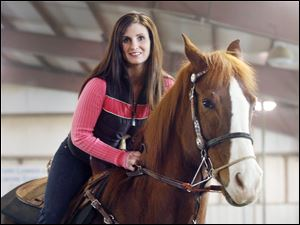 Amanda Thompson founded Healing of Veterans through Equine Assisted Services to help veterans by working with horses.