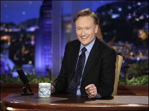 "In this June 1, 2009 file photo provided by NBC, Conan O'Brien makes his debut as the host of NBC's ""The Tonight Show"" in Universal City, Calif."