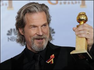 Jeff Bridges poses with the award for best actor in a motion picture drama for 'Crazy Heart'.