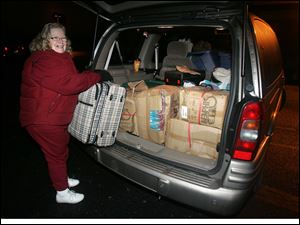 Marci Moussa, a member of Calvary United Methodist Church, is ready for the trip to New Orleans. Volunteers from Maine to California have tried to help New Orleans get back on its feet.