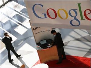 Google logo is displayed at the National Retail Federation convention in New York. Google on Wednesday, Feb. 10, 2010 said it plans to build experimental, ultra-fast Internet networks in a handful of communities around the country.