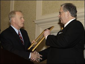 Gov. Ted Strickland, left, presents The Blade president and general manager Joe Zerbey with a proclamation for its 175th year of publishing Wednesday, Feb. 10, 2010, in Columbus, Ohio.<br>