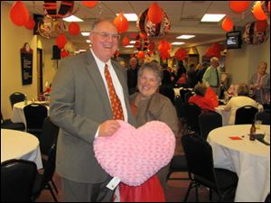 MALCOLM and PEGGY RICHARDS hold