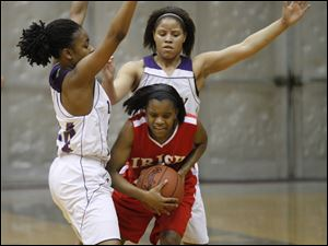 Waite's Miriah Haynes, left, and Courtney Jackson surround Central Catholic's Brianna Rogers on defense.