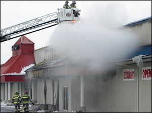 Firefighters battles a blaze at Stony Ridge Inn in Millbury.