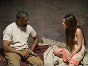 Denzel Washington plays Eli and Mila Kunis is Solara in the postapocalyptic