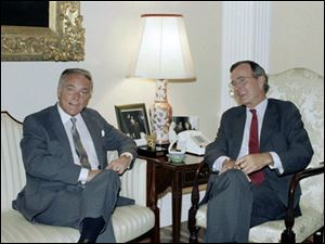 In this Sept. 25, 1985 file photo, U.S. Vice President George H.W. Bush meets with former Secretary of State Alexander Haig. Haig, who served Republican presidents and ran for the office himself, has died, Saturday, Feb. 20, 2010. He was 85.