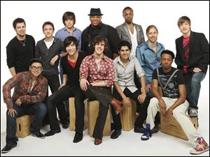 "In this publicity image released by Fox, the 12 male finalists for the ninth season of the reality singing competetion, ""American Idol,"" front row from left, Andrew Garcia, John Park, Tyler Grady, Joe Munoz and Jermaine Sellers and, back row, from left, Lee Dewyze, Aaron Kelly, Tim Urban, Michael Lynche, Todrick Hall, Casey James and Alex Lambert, are shown."