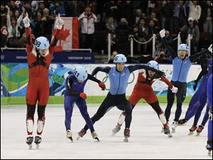 Canada's Francois-Louis Tremblay, left, reacts after winnin