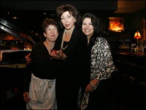 Kelley Berry, left, Fifi Berry, center, and Sena Mourad enjoy the Valentine's luncheon and fashion show at Fifi's.