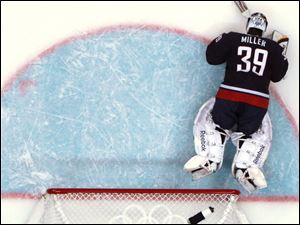 U.S. goalie Ryan Miller lies on the ice after giving up the game-winning goal to Sidney Crosby.
