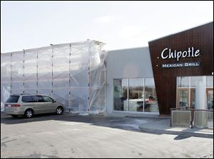 BIZ build07p   3/3/2010  The Blade/Dave Zapotosky An AutoZone store, left, is being constructed in an existing building  at 7229 West Central Ave. in Toledo, Ohio, March 3, 2010.