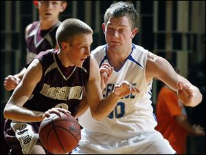Rossford's Josh Perry tries to get past Defiance's Dace Kime in last night's Division II district semifinal.