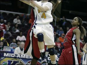 Toledo's Naama Shafir, who had 18 points, drives to the basket against Ball State in a MAC quarterfinal in Cleveland.