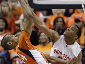 Ohio State's Evan Turner blocks a shot by Illinois' Mike Davis in the second ha