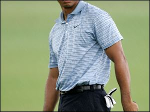 Tiger Woods will end four months of seclusion when he plays at the Masters in April.