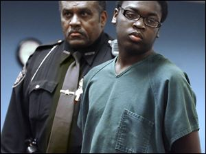 Anferney Fontenet, 15, is escorted from a courtroom after Juvenile Court Judge Connie Zemmelman ruled yesterday that the youth would be sent to adult court to face rape and robbery charges. The judge cited information about the youth's involvement in a 2008 rape attempt.
