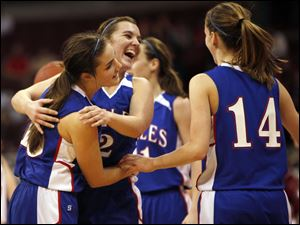 Liberty-Benton's Caite Craft, left, celebrates the Eagles state championship win with teammates Catelen Ramsey, (2) and Amber Petersen (14). It was the first girls state title and first perfect year.