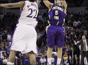 Northern Iowa's Ali Farokhmanesh shoots over Kansas' Marcus Morris as the Panthers upset KU.