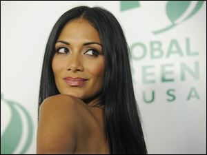Nicole Scherzinger of the Pussycat Dolls poses at Global Green USA&