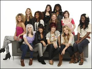 "In this publicity image released by Fox, the 12 female finalists for the ninth season of the reality singing competetion, ""American Idol,"" seated from left, Katelyn Epperly, Lilly Scott, Ashley Rodriguez, Lacey Brown, Janell Wheeler, Haeley Vaughn and, standing from left, Didi Benami, Michelle Delamor, Katie Stevens, Crystal Bowersox, Paige Miles and  Soibhan Magnus, are shown."