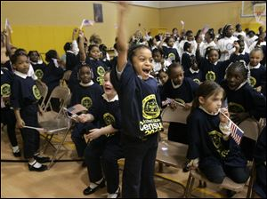 Happy students at the Ella P. Stewart Academy for Girls in Toledo including Jiliyah Easter, center, react after a surprise performance by the Zion City Drum Corps. The school, in conjunction with the Toledo Unit of the NAACP, hosted a '2010 Census Extravaganza' yesterday.