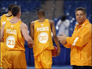 Coach Bruce Pearl and the Vols battled back from the arrest and suspension of key players over drugs and weapons charges.