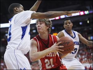 Port Clinton's Derek Colston is pressured by Dayton Dunbar's Ryan Bass, left, and Deontae Hawkins in the D-II state final.