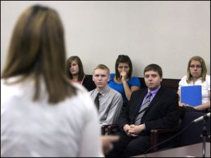 Jessica Walls, foreground, addresses a Teen Court jury that includes, front from left, Chris Woessner of Bowling Green High School and John Vrzal of Perrysburg High School and, back from left, Jessica McKenzie of Elmwood High School, Bre Hitchen of Lake High School, and Jane Powell of North Baltimore High School.