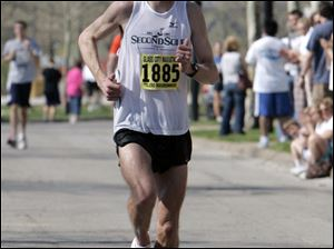 Matt Folk won the 2009 Glass City Marathon in 2 hours, 31 minutes and 4 seconds.