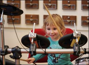 The 'Bang a Drum' event is a hit with Sabina Bielski, 3, of