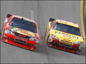 Kevin Harvick, right, drops low to pass