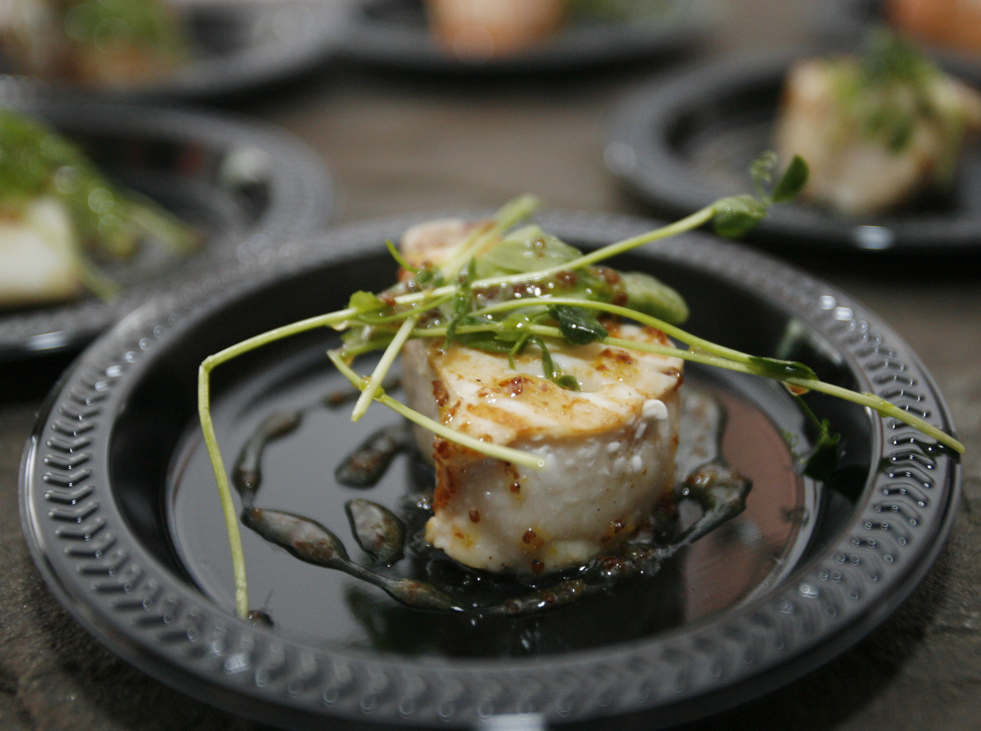 Celebrity chefs local restaurants cook up delicious fund for Fat fish blue toledo