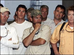 Charter and commercial fishermen listen to National Oceanic and Atmospheric Administration administrator Jane Lubchenco, not pictured, in Venice, La., Friday, April 30, 2010. Local fishermen are worried about how their industry will withstand a growing oil spill that resulted from last week's explosion and collapse of the Deepwater Horizon oil rig in the Gulf of Mexico near the coast of Louisiana.