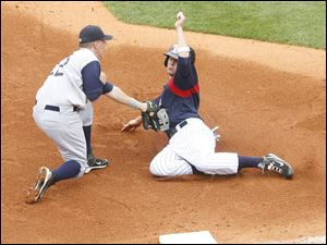 Charlotte third baseman C.J. Retherford tags out Jeff Larish in the fourth inning during Sunday's game at Fifth Third Field.