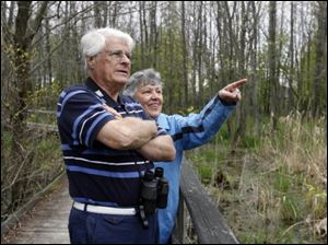 John Mang and Rita Beckman of Oregon watch at Maumee Bay State Park for birds like a red-winged blackbird, below.