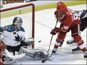 Detroit's Tomas Holmstrom puts the puck past San Jose goalie Evgeni Nabokov but the Sharks rallied from a 3-1 deficit to win.