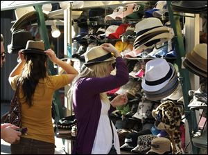 L.A. consumers try on hats. New data show a cooloff in April but a good spring season overall for retailers, especially wholesale clubs such as Costco and luxury retailers such as Nordstrom Inc.