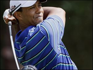 Tiger Woods struggled at times yesterday, but he still managed a 2-under 70, which was nine shots better than his last round.