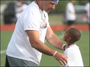 Chris Spielman's campers are too young to have seen him play, but he has a presence that gets their attention and motivates them.
