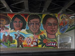 Frida Kahlo, right, is among the local and international heroes depicted on the mural, which took 10 days to complete and involved area residents, artists, students, and teachers.