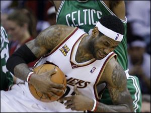 LeBron James, being fouled by Boston's Glen Davis, had just 15 points in a Game 5 loss.