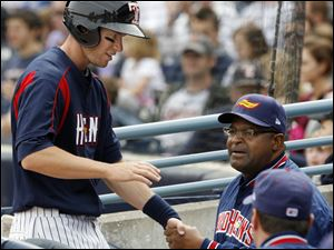 Toledo's Jeff Frazier is congratulated by coach Leon Durham after scoring a run in the fourth against Indianapolis at Fifth Third Field.